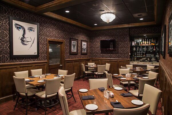 A private dining room at Frankie Bones is a separate room away from the main restaurant dining area that provides guests total privacy